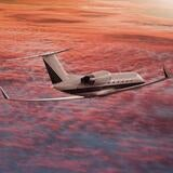 Business Jet flying over clouded sunset