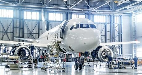 Aircraft under maintenance in hangar